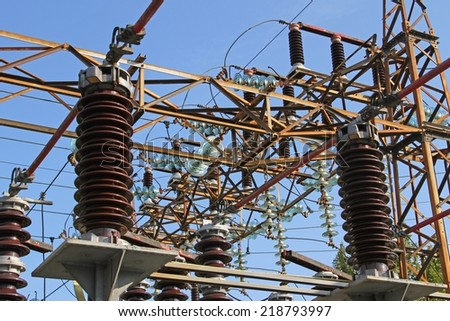 huge high-voltage switches in outdoor power station - stock photo