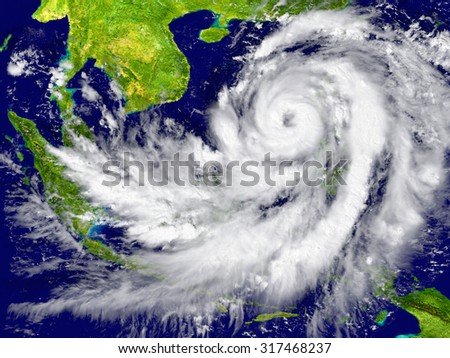 Huge hurricane near Southeast Asia. Elements of this image furnished by NASA - stock photo