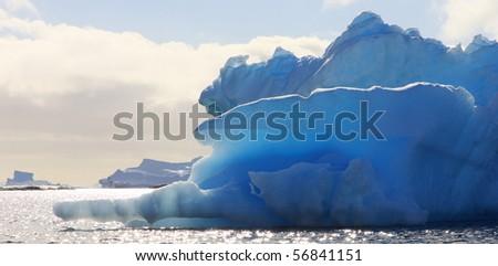 Huge iceberg in Antarctica, blue sky, azure water, sunny day. - stock photo