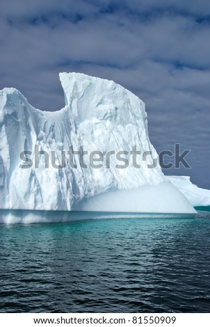Huge iceberg in sea nearby Antarctica - stock photo