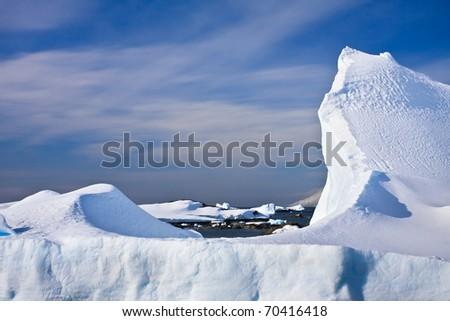 Huge icebergs in Antarctica, blue sky, sunny day - stock photo