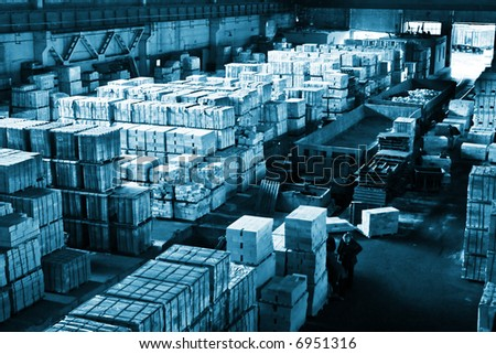 Huge industrial space hosting a finished-products storage area - stock photo