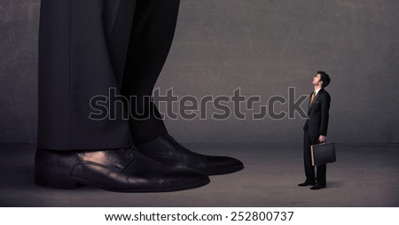 Huge legs with small businessman standing in front concept on background - stock photo