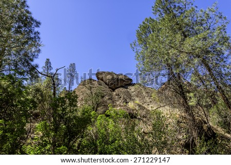 Huge massive heart / pit viper shaped rock at Pinnacles National Park in Monterey County, California, near the Salinas Valley, on the California Central Coast. - stock photo