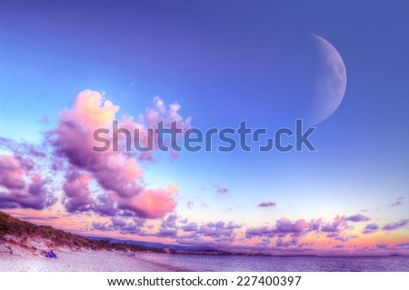 Huge moon over Alghero at sunset. Heavy processed for hdr tone mapping effect. - stock photo