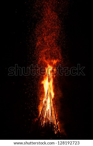 Huge night fire with sparks against a dark - stock photo