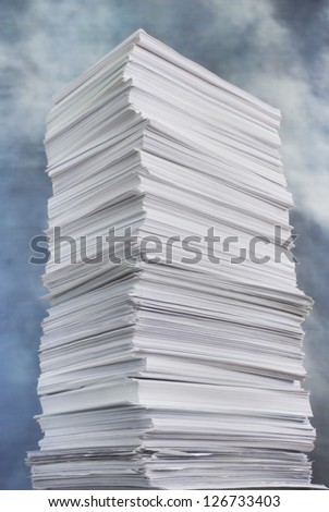 huge paper stack against the stormy sky - stock photo