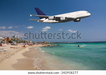 Huge plane flying over the beach during your vacation - stock photo