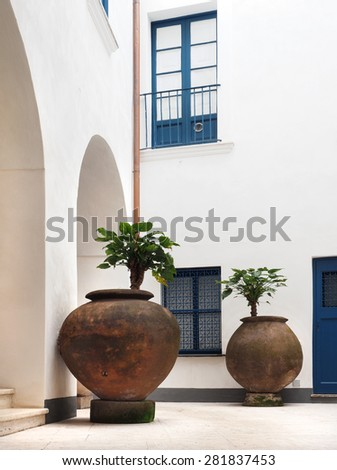 Huge Potted Plants in a Building Courtyard          - stock photo