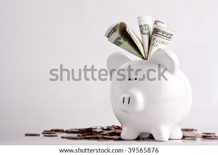 Huge savings in the piggy bank, overflowing with cash - stock photo