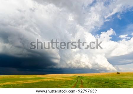 Huge shelf cloud approaching - stock photo