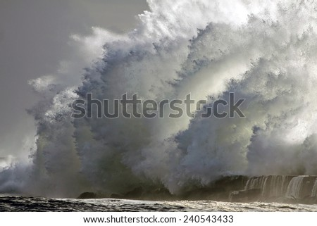 Huge stormy wave over mouth of river Ave pier, Vila do Conde, north of Portugal - stock photo
