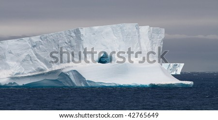 Huge Tabular Iceberg Floating in Bransfield Strait, Antarctic Peninsula, Antarctica - stock photo