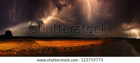 Huge thunders in a field in the evening. - stock photo