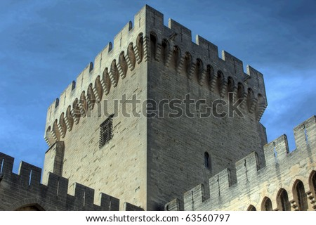 Huge tower with crenellations in a medieval castle - stock photo
