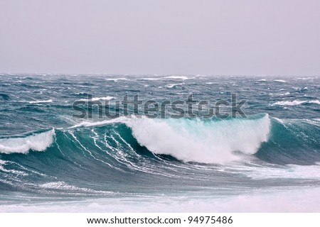 Huge turquoise white rolling wave - stock photo