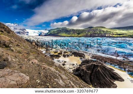 Huge Vatnajokull glacier and mountains in Iceland - stock photo