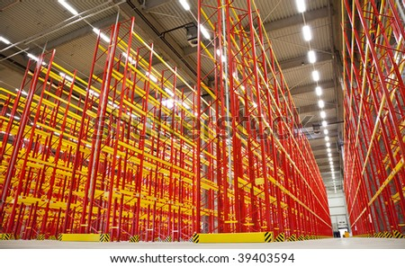 huge warehouse inside with empty racks in red - stock photo