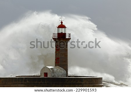 Huge wave over old lighthouse of Porto, Portugal - stock photo