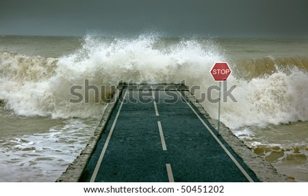 Huge waves, covering highway - stock photo