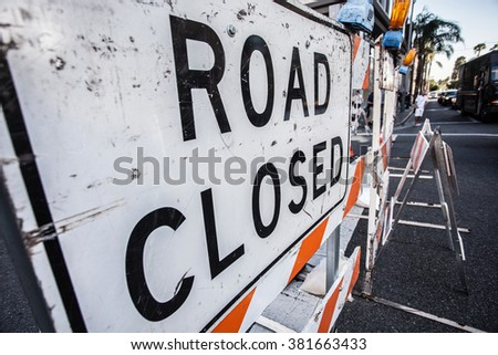 Huge worn out sign Road Closed in the middle of the city - stock photo