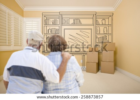 Hugging Senior Couple In Empty Room with Shelf Design Drawing on Wall. - stock photo