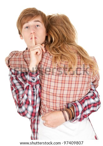 hugging young couple, man with finger on mouth, keeping silence - stock photo
