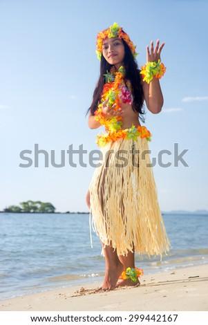 Hula Hawaii dancer dancing on the sea beach. Exotic vacation on a tropical island.. - stock photo