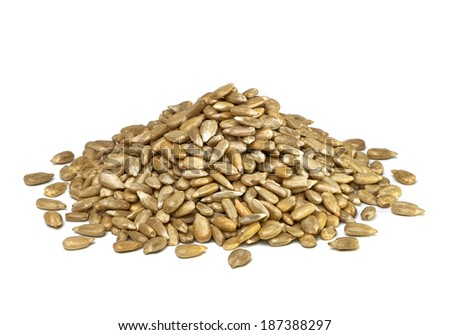 Hullled sunflower seeds pile on white background - stock photo
