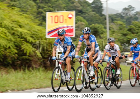 HULU LANGAT, MALAYSIA - FEBRUARY 28: A group of cyclist participates in Stage 5 of the Ayer Keroh - Pandan Indah for the 2012 Le Tour de Langkawi on Feb. 28, 2012 in Hulu Langat, Malaysia - stock photo