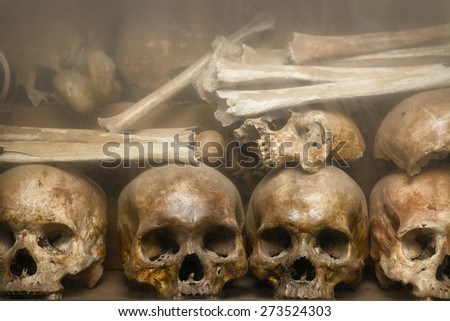 Human bones and skulls, arranged and displayed on a shelf at Tuol Sleng Genocide Museum, the site of a former concentration camp and execution center in Cambodia. - stock photo