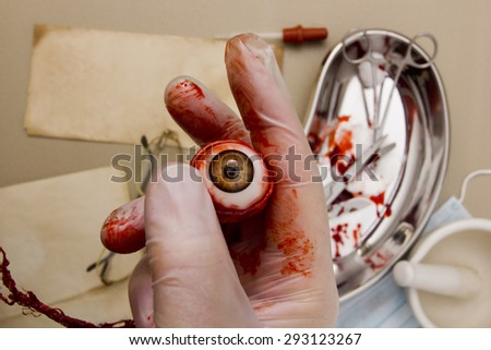 Human eye in the hand of the surgeon. - stock photo