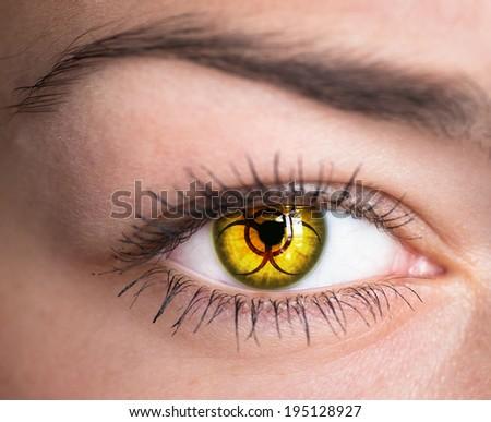 Human eye with biohazard symbol - concept photo.   - stock photo