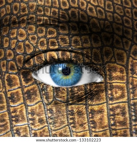 Human eye with lizard skin texture - Mutation concept - stock photo