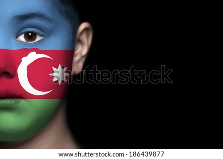 Human face painted with flag of Azerbaijan - stock photo