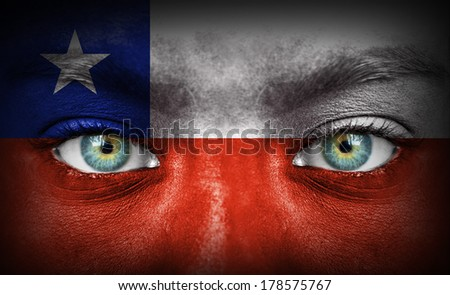 Human face painted with flag of Chile - stock photo