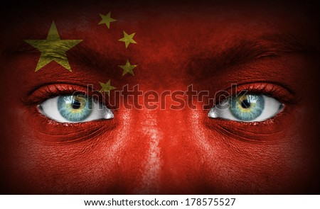 Human face painted with flag of China - stock photo