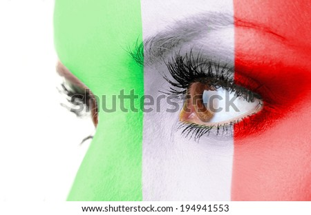 Human face painted with flag of Italy - stock photo