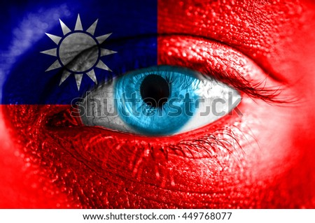 Human face painted with flag of Taiwan  - stock photo