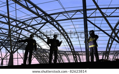 Human figures builders in the sky. - stock photo