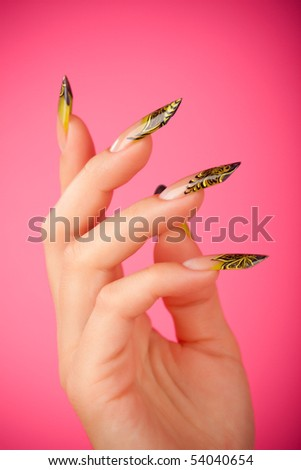 Human fingers with beautiful manicure in natural mint green style over pink - stock photo