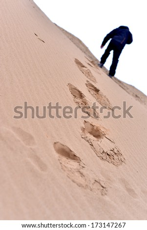 Human footsteps in the sand - stock photo