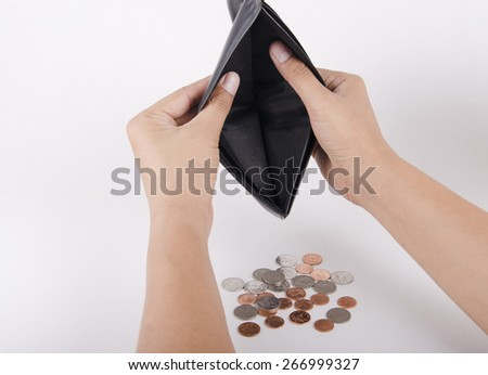 Human hand and empty wallet - broke - stock photo