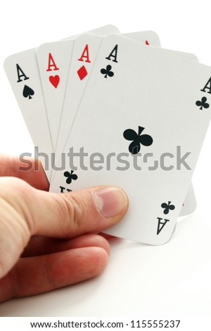Human hand and four aces cards over white background - stock photo