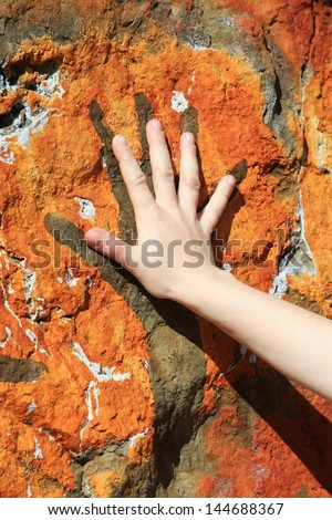 human hand and painting on rock - stock photo