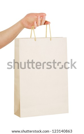 human hand carry blank slate beige paper bag isolated on white background - stock photo