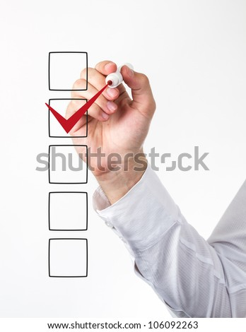Human hand checking the checklist boxes - stock photo