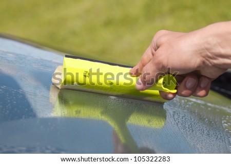 Human hand cleaning window. - stock photo