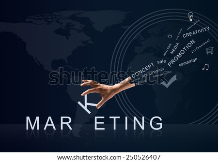 Human hand connecting letters of word marketing - stock photo