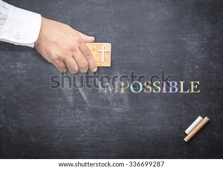Human hand erased alphabet I, M from a chalkboard for changing to POSSIBLE. The word IMPOSSIBLE erased from a blackboard. Concept of Trust, Believe, God Can, Change Management, Transformation. - stock photo